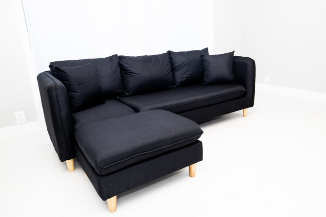 A sexy looking small reversible sectional sofa. It looks really hot.